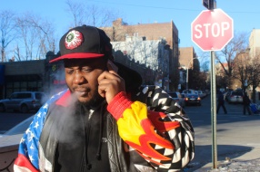 Rapper and Soundtrack Producer Dante Stevenson, who goes by $leezus and Soulebrity, on a call with his barber in the Bronx, NYC, 02/28/2014 ©Sumi Naidoo, 2014