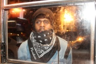 Photographer Mitchell Louis, 31, peeks in through the window of The Flat in Brooklyn, NYC, 02/07/2014 ©Sumi Naidoo, 2014